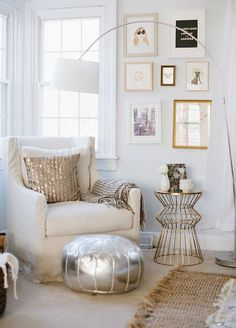 The Glitter Guide - living rooms - beige carpet, rug on carpet, rug over carpet, braided jute rug, braided sisal rug, silver pouf, silver me...