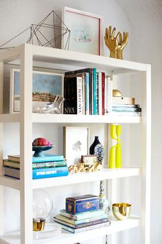 art frames - emily-henderson-display-book-shelf-tower-art-collection-white-colorful-west-elm