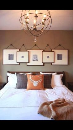 Master Bedroom- simple, masculine, unique idea for photos, pop of orange