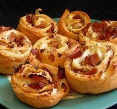 Onion-Bacon Crescent Bites   Ingredients 3 slices bacon, cut into pieces 1/2 cup chopped onion 1 (3 ounce) packages cream cheese, softened 1/3 cup shredded cheddar cheese 1 tablespoon finely chopped fresh parsley 1/2 teaspoon paprika 1/4 teaspoon caraway seed, crushed 1 (8 ounce) cans Pillsbury Refrigerated Crescent Dinner Rolls Directions Heat oven to 375°F Spray cookie sheet with cooking spray. In 6-inch skillet, cook bacon over medium heat 3 minutes. Add onion; cook 3 to 5 minutes or ...