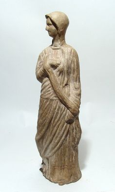 A large Greek Tanagra hollow-cast pottery figure of a robed woman, c. 3rd - 2nd Century BC