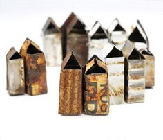 Kat Cole  tiny houses made of old recycled rusted iron cans...
