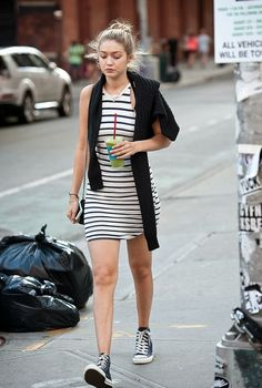 Striped mini dress with a draped sweater and high top Converse.