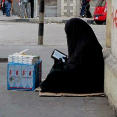 Somali woman she is working and Reading quran