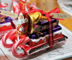 candy cane sleigh | As you can see we have candy canes, KitKat, miniature Cadbury ... Beverages, Drinks, Christmas Party Games, Christmas Love, Coca Cola, Chocolate Santa, Sled, Favors, Canning