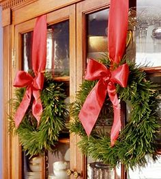 wreaths hung on cabinet doors.