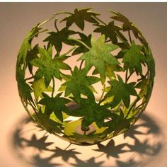 Stick overlapping leaves over a round balloon. Let glue dry. Burst the balloon and you're left with a thing of delicate beauty. Fun to do and to display!  Source: Rob Glebe Design