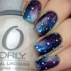 """Galaxy nails using a ton of colors (listed below) sponged on with a foundation wedge.   *Orly's """"Goth"""" and """"Au Champagne"""" *Avon's """"Platinum Beauty"""" and """"Sparkling Sky"""" *Essie's """"Sexy Divide""""  *Sally Hansen's """"Freeze!"""" and """"Ice Queen"""""""