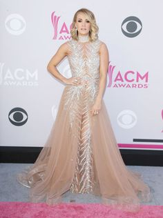 Carrie Underwood looked every bit the part of country music princess in this incredible nude and crystal-encrusted LaBourjoisie dress. The gorgeous Harry Kotlar earrings she paired with this look accentuated her glowing complexion.
