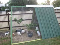 Give your old swing set's A-frame structure new life as a coop by attaching iron sheets and covering it with mesh netting. Learn more at JoJoChooks Blog.   - CountryLiving.com