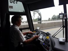 Driver, Willard Hansen behind the wheel of a Hawkeye Stages motorcoach on a recent tour to Philadelphia and New York.