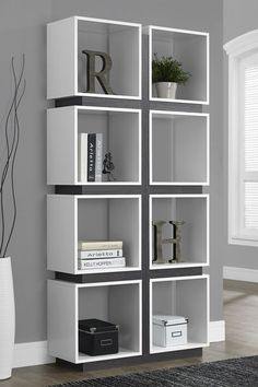 "White/Grey Eight Cube Bookcase b y Monarch Specialties Details: Give your home a modern art-deco look with this 8 cubic shelf bookcase. This perfectly symmetrical bookcase has 8 cubic spaces to showcase all your collectibles. With an open back, this piece can also be used as a room separator. Featuring sturdy hollow-core shelves in a white/grey finish, this unit will be the focal point of any room. - Color: white/grey - 34"" L x 12"" W x 71"" H - Imported $378."