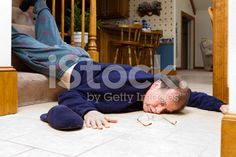 Adult male, prostrate from a fall lays on the floor. royalty-free stock photo