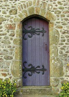 Beautiful old purple door with ironwork.