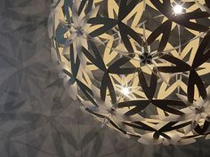 David Trubridge's new Manuka lamp is a giant, spherical lamp with delicate flower-shaped lattice patterning that leaves star-shaped shadows on nearby surfaces.