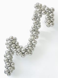 Perfect for a 'Vintage Christmas' theme, this silver plastic ball holiday garland has the look of antique mercury glass.