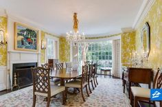 Deck your dining room out with patterned wallpaper and a large rug for a timeless, elegant look.