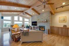 Vaulted great room with windows that, on a clear day, offer spectacular views. Designed and built by Quail Homes of Vancouver Washington.