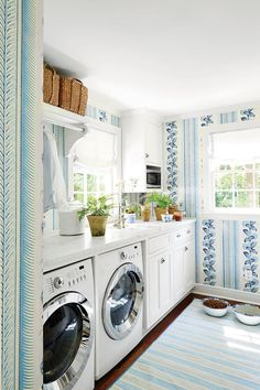 The Laundry Room - How To Master Classic Georgian Style - Southernliving. Because Bartholomew spends so much time in the laundry room, it was important to her that it be pretty. She papered the walls with Quadrille's Climbing Hydrangea and keeps the space filled with plants.