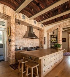 Rustic elements like Curved wood slat ceiling and brick walls give the transitional kitchen a timeless look [Design: Wynand Wilsenach Architects] - Decoist Brick Wall Kitchen, Old Brick Wall, New Kitchen Cabinets, Brick Walls, Brick Arch, Blue Cabinets, Kitchen Island, Wood Slat Ceiling, Wood Slats