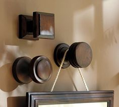 Curtain rod finials as picture hooks... (think either restoration hardware or pb)
