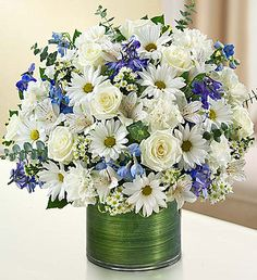 Cherished Memories - Blue and White This graceful gathering of roses, delphinium, alstroemeria, carnations and daisy poms is elegantly arranged in a stylish cylinder vase. Funeral Flower Arrangements, Beautiful Flower Arrangements, Funeral Flowers, White Flowers, Beautiful Flowers, Wedding Flowers, White Roses, Purple Flowers, Purple Bouquets