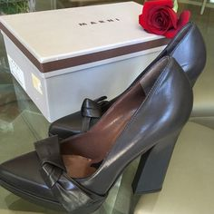 Brand New Vintage Marni Lamb Leather Heels Beautiful brand new, never worn vintage Marni designer pumps. Dust bag and box. Spherical green lambskin leather. Appear dark gray in person. Unique style with the heel, bow appliqué, and pointed toe. ❤️ Marni Shoes Platforms
