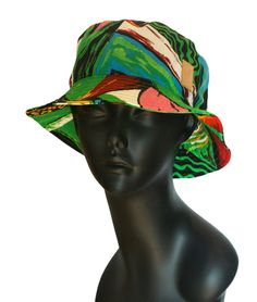68bb8302140 Light weight and breezy abstract printed bucket hat made of woven cotton  and features logo skull leather patch.  One size fits all brim width
