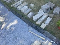 More stones gifted from Frank Sandborn. straight pieces of granite counter top. One side is polished. I want to use these as an edging between the grass and the 1/4' minus gravel but I'm missing about 3 feet. Not sure how that is going to work.