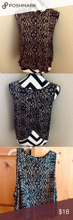 ADORABLE SLEEVELESS SPLITBACK BLOUSE Worn twice! Black & tan aztec-like design sleeveless top is slightly split up the back. Rayon/spandex blend in Size Medium by Full Tilt from Tilly's. Full Tilt Tops Blouses