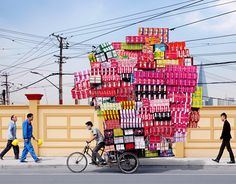 Some nice and surreal photographs of epic loads on the back of bikes in Shanghai!