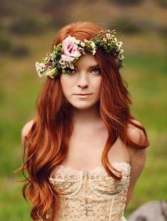 Georgeous redhead with long hair & curls. Flowers make her glow even more.