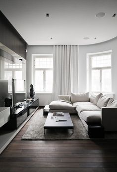 Cozy Living Room, great concept to bring the curtain up to the ceiling