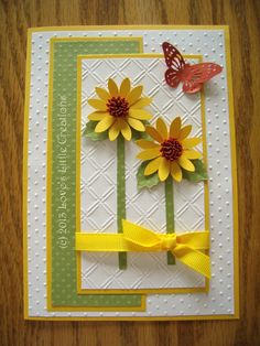 One of my own cards, (my card business name is Love's Little Creations). Used 2 Cuttlebug embossing folders and the Cricut Flower Shoppe cartridge. The butterfly was cut through the Cricut Craft Room freebie.