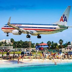 Watching airliners pass over is a popular activity at Maho Beach - located at the Caribbean island of Saint Martin. Daily arrivals and departures airline timetables are displayed on a board in most bars and restaurants on the beach to keep visitors entertained   In the picture an American 738 arrives at SXM (Princess Juliana Airport). Shot by @photojasinski --- SXM products are available at: http://ift.tt/2kh2qws
