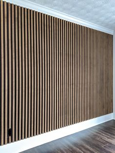 Ever since the first time I saw a slat wall, I couldn't wait to add one to my home! I have seen many different styles (plain wood against a white wall, painted wood on a painted wall…) … Wood Slat Wall, Wood Slats, Wood Paneling, Modern Wall Paneling, Panelling, Wood Panel Walls, Decorative Wall Panels, 3d Wall Panels, Wall Treatments