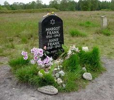 Anne Frank and her older sister, Margot, both died of typhus at Bergen-Belsen shortly before the liberation. A tombstone for them has been placed at the site of the former camp, but Anne and her sister are buried in one of the mass graves. No one knows the exact location of their remains. In the background of the photo is one of the mass graves.