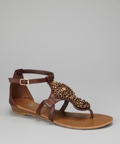 The combination of rhinestones and beads makes these adjustable-strap sandals simply irresistible. Any fashion-loving gal will giggle with glee because these sweet sandals are a sight to be seen.1'' heelBuckle closureMan madeImported
