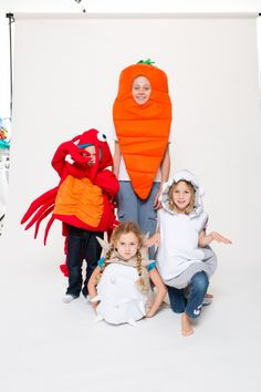 Glammic custom Halloween costumes, all handmade at our worldwide headquarters, featuring our carrot, shark, blowfish, and lobster.