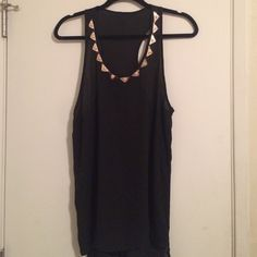 Cute tank with detail ❣ Sheer black racerback tank with gold tiger detail around backline. It's got a little bit of extra material on the back so it's like a high low tank. Size large. please no trades all sales come with a thank you gift. Comment with questions. Thanks  please use offer button. No negotiations over comments Tops Tank Tops