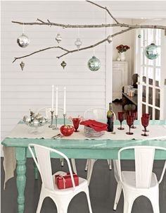 Beautiful Modern Christmas Table Setting with Tree branch and hanging ornaments. Centerpiece Christmas, Christmas Chandelier, Scandinavian Christmas Decorations, Christmas Table Settings, Christmas Table Decorations, Holiday Tables, Hanging Decorations, Centerpiece Ideas, Hanging Centerpiece