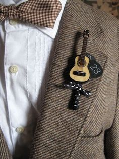little something extra for your groom.. guitar boutonniere