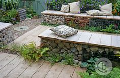 Ben Chandler Landscape & Garden Design - Tunbridge Wells - Hessian sack cushions on a gabion seat with reclaimed scaffold board seat tops and deck