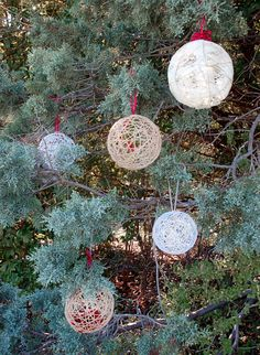 DIY String Ornaments!! use twine or bracelt/crft string, soak in white craft glue mixed with just a little bit of water, wrap string around various sized balloons, let sit for 24 hours (until glue is dry) and then pop and remove the balloon! hang with festive hooks or ribbons