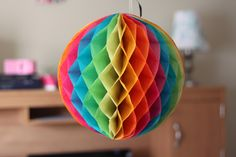 DIY: honeycomb balls ...make easter egg shape for easter ...fabric or magazine pgs