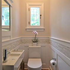 We can do this to the guest bathroom and make it look so finished. board and batten wainscot with mosaic border