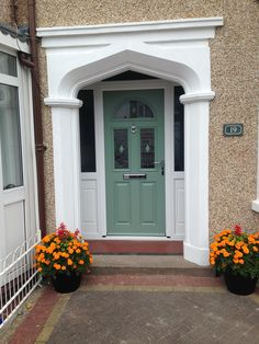 Chartwell green composite door in a white upvc frame. Installed by Windseal Double Glazing based in Coventry & Warwickshire Front Doors, Garage Doors, Composite Front Door, Coventry, House Colors, Composition, Colour, Traditional, Frame