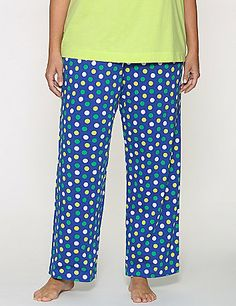 Soft knit sleep pant outfits bedtime or lazy days at home in a charming polka dot print. Easy-wearing elastic waist with drawstring closure. lanebryant.com