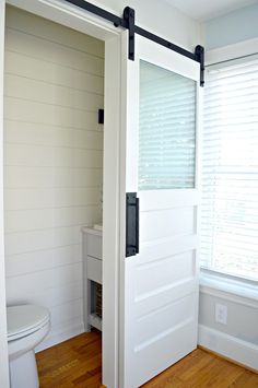 small powder room with a white painted barn door with frosted glass window - March 03 2019 at Powder Room Small, House Bathroom, Frosted Glass Door, Bathroom Barn Door, Room Doors, Glass Bathroom, Diy Door, Bathrooms Remodel, Glass Bathroom Door
