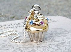 10 OFF SALEBlinged Out Cupcake Necklace Sterling by DivineByDeidre. $36.00, via Etsy.